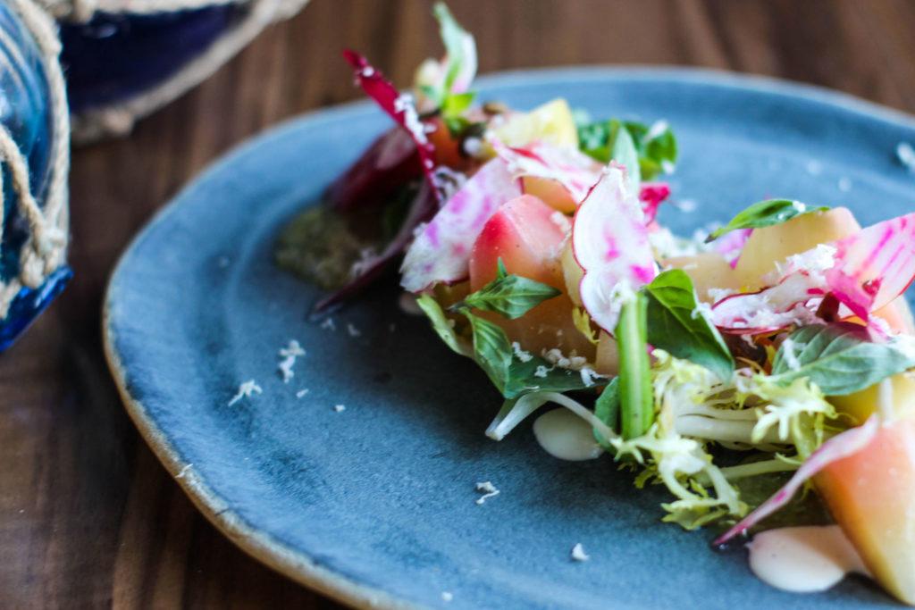 fresh beet salad on blue stoneware plate