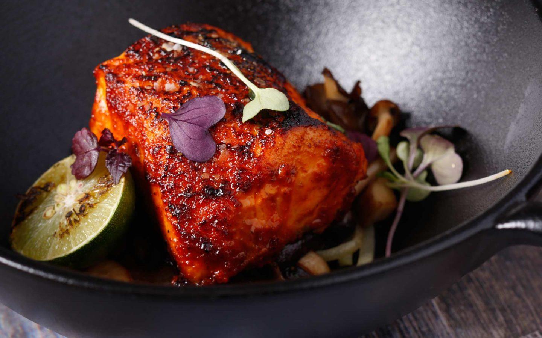 Black cod dish with garnish in pan