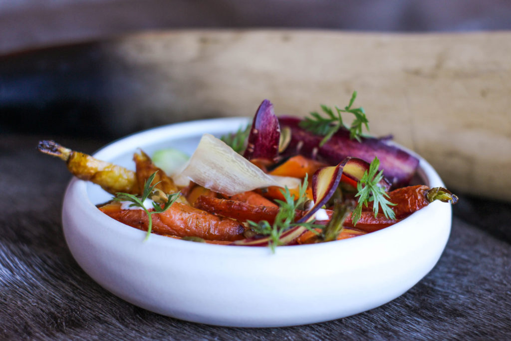 garnished carrot dish in white low rimmed bowl